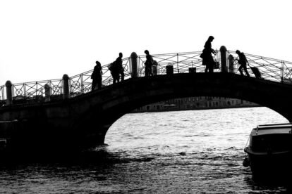 busy people crossing a bridge