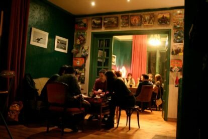 people in a cafe with board games around