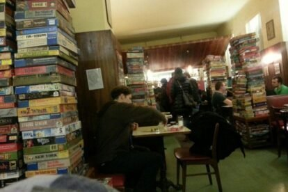 man in a cafe with board games around