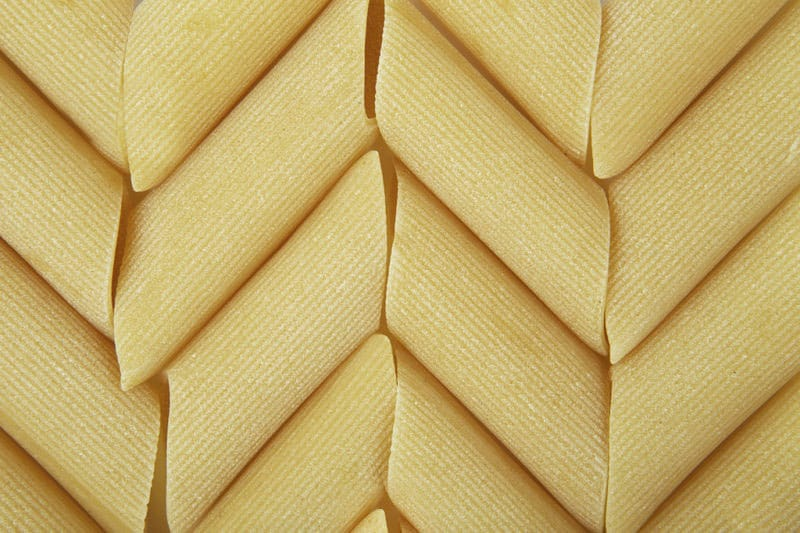 background of italian penne, traditional pasta