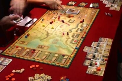 board game with hands playing