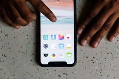 Hands using a smartphone