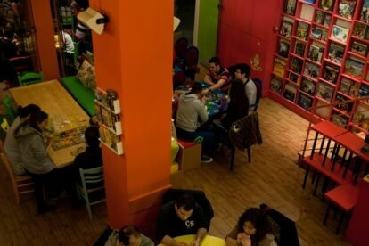 people playing board games indoors